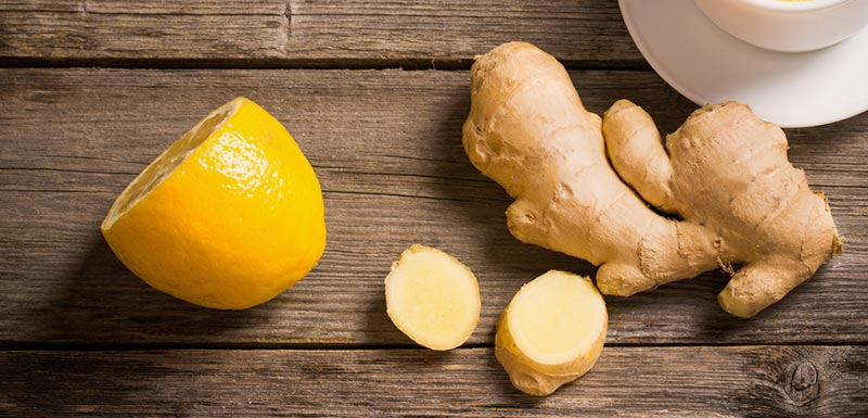 Lemon and ginger on table